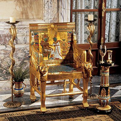 This is a replica of an Egyptian style chair It has the poles