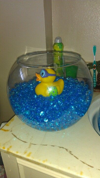 Rubber duckie baby shower centerpiece do a guess how many for Rubber ducky bathroom ideas