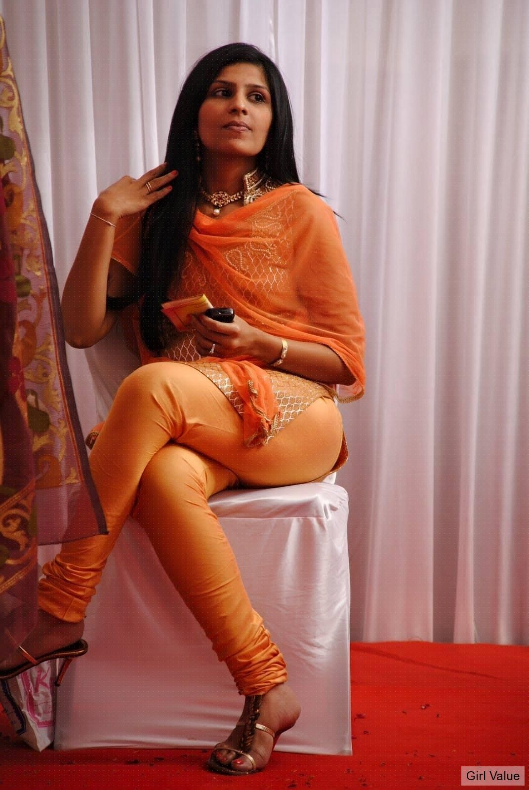 Indian girl in orange salwar kameez dress
