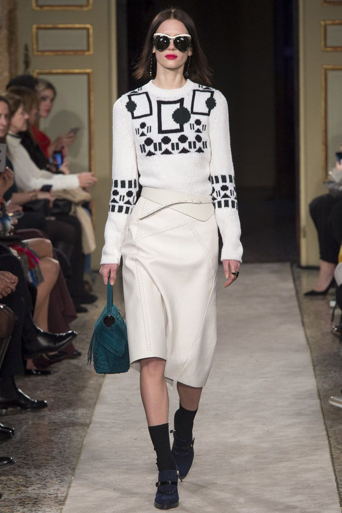 Tod's:  Knit Sweater with white leather skirt.