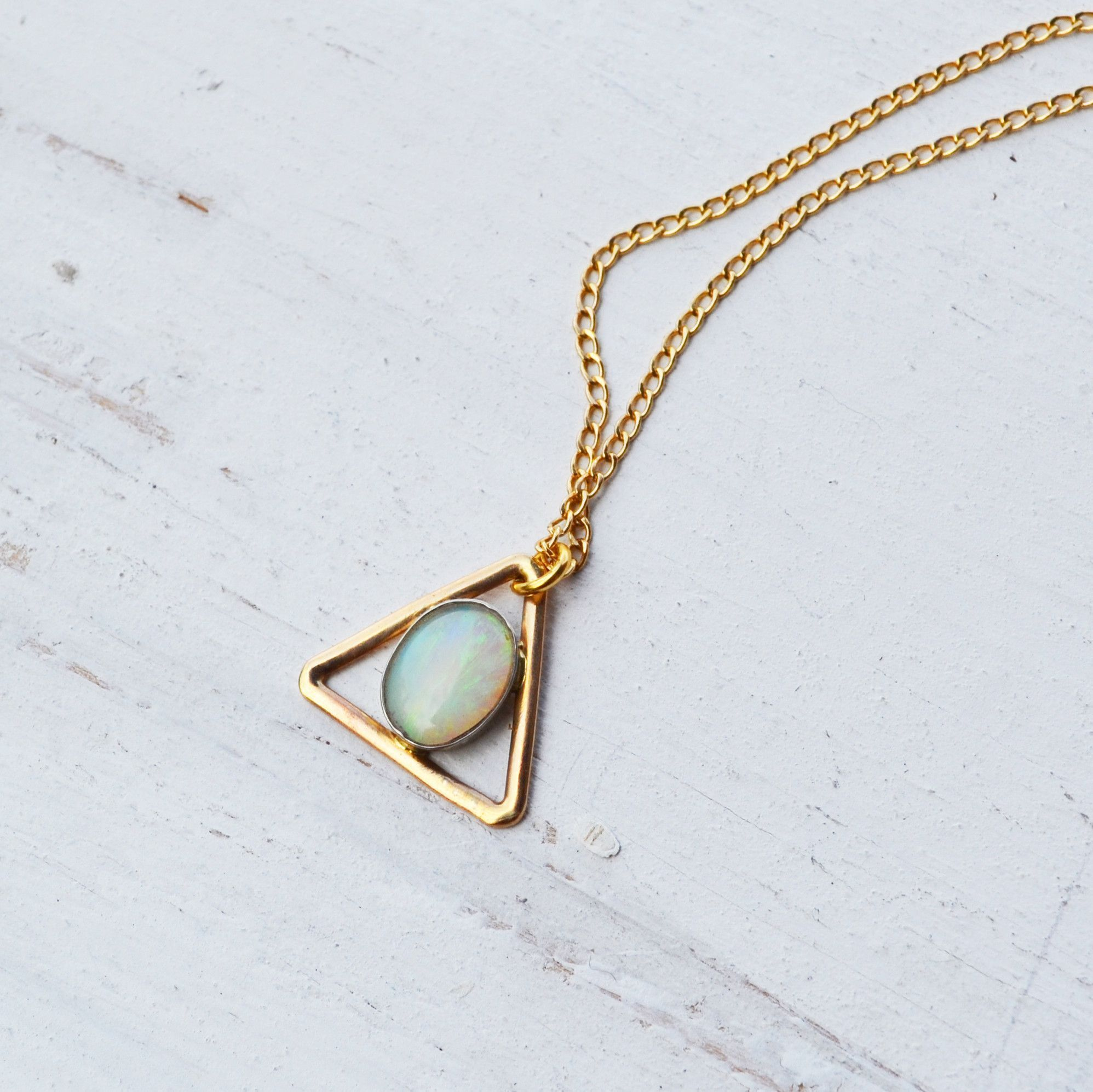 A soft milky bluegreen australian opal opal is hand set into a