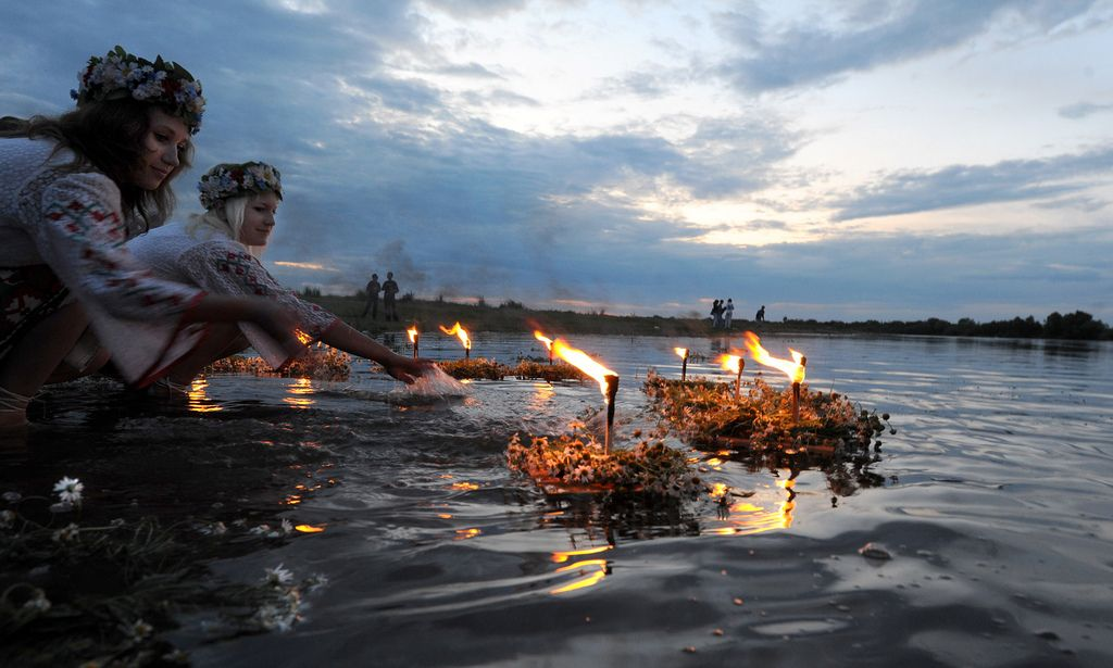 orthodoxwayoflife:    Belarusians place candles in the river while celebrating Ivan Kupala, the feast of St. John the Baptist, a traditional Slavic orthodox holiday celebrating the summer solstice, 270 kilometers south from Minsk in Turov early on July 7, 2010.  AFP PHOTO / VIKTOR DRACHEV (Photo credit should read VIKTOR DRACHEV/AFP/Getty Images)  Photo by On Being