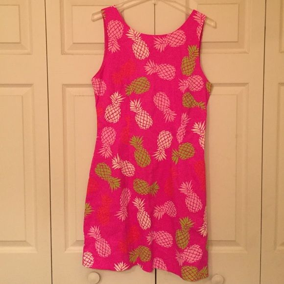 MacBeth Collection Pink Pineapple Dress Adorable pineapple print dress found at boutiques and stores like Dillards.  This dress has never been worn and has the original Macbeth tag attached. Is a size large. Has an exposed zipper detail with lime green outlining. Super cute. Has small black stain on bottom that can wash out, just never tried. I bought it with small stain. No trades. MacBeth Collection Dresses Asymmetrical