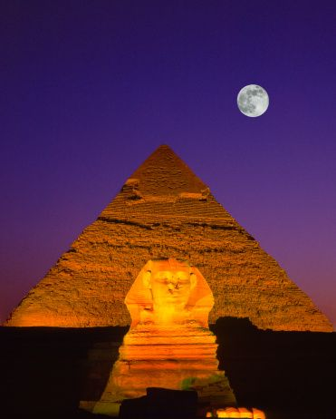 Sphinx & pyramid illuminated at night with full moon | Oh, what