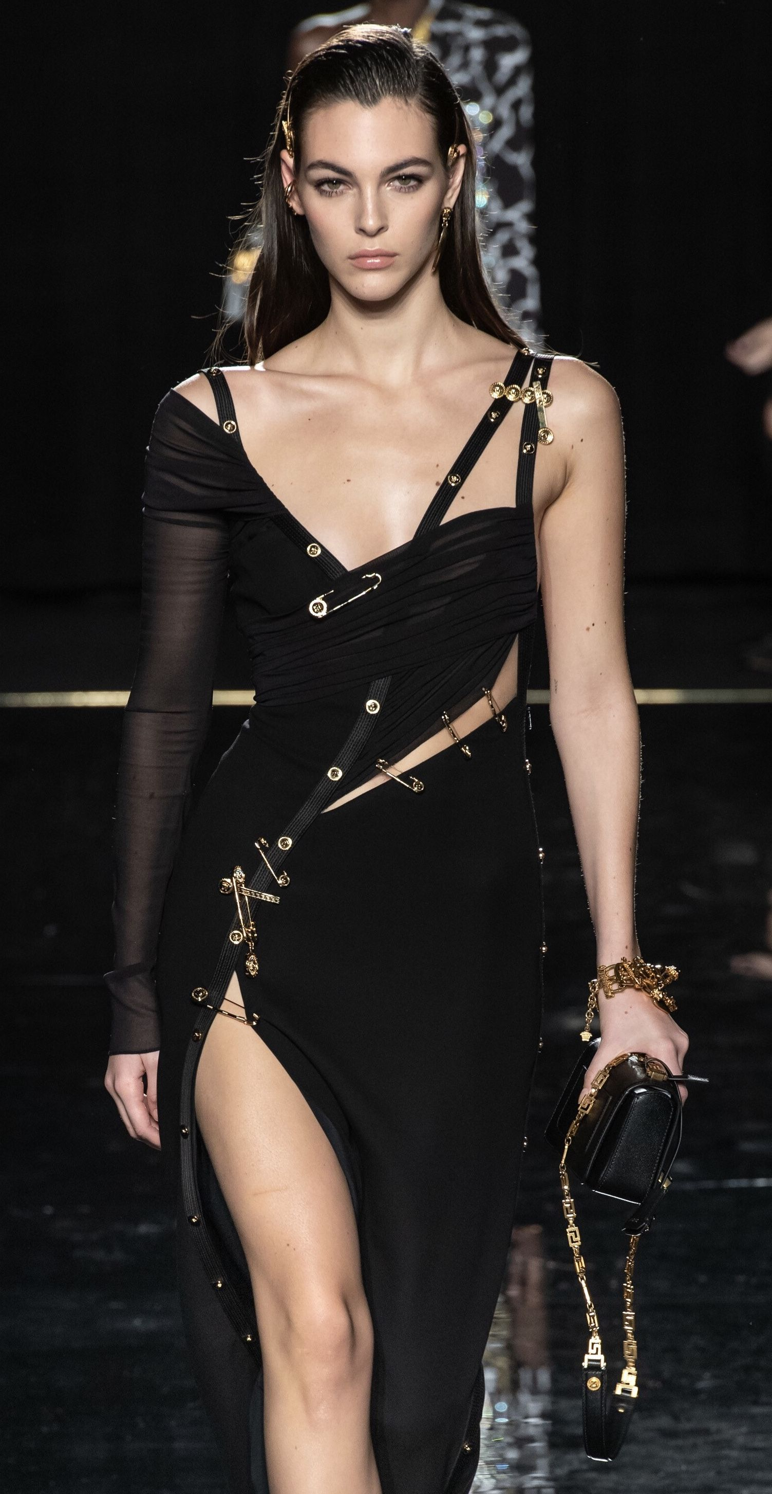 501b0f23209 Versace 2019 tribute to the iconic safety pin dress. Model  Vittoria Ceretti