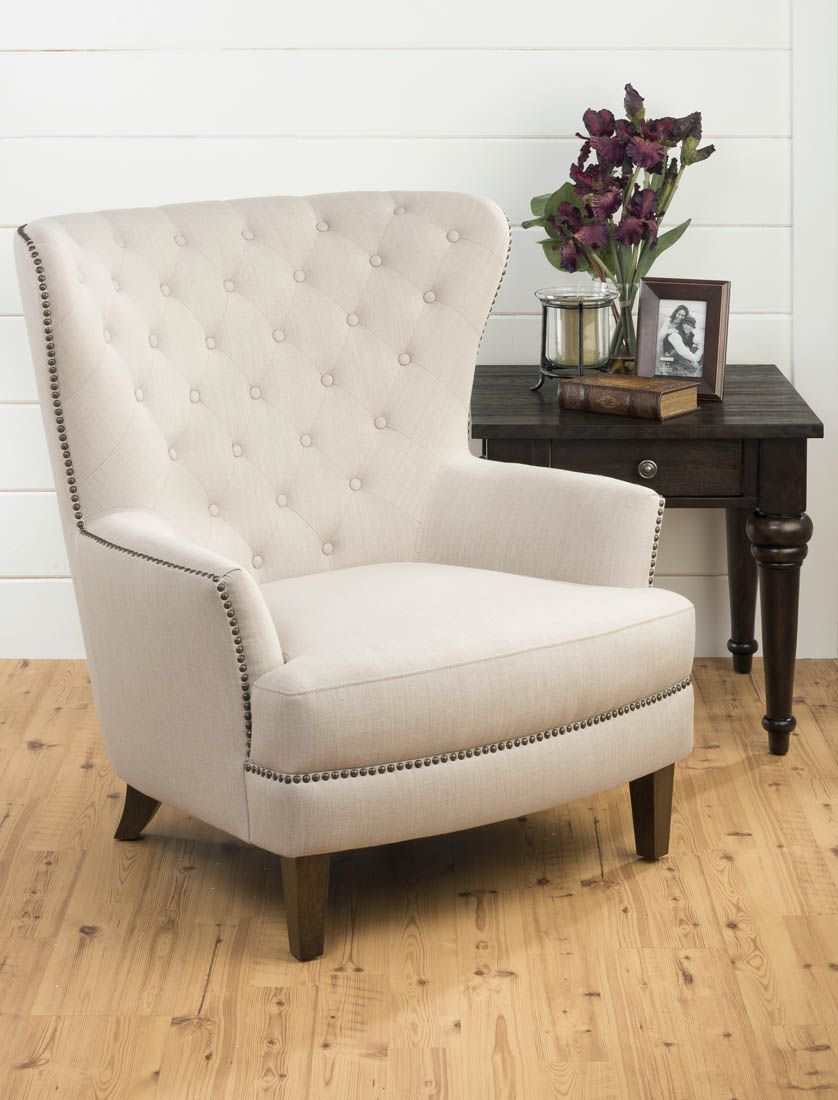 Upholstered tufted accent chair