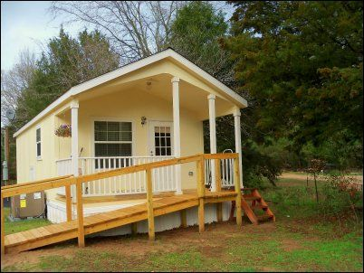 Her Little House Is 12ft X 30ft And Includes A Six Foot Covered Porch Inside Is A Full Kitchen Living R Small House Living Small House Garage Unusual Homes