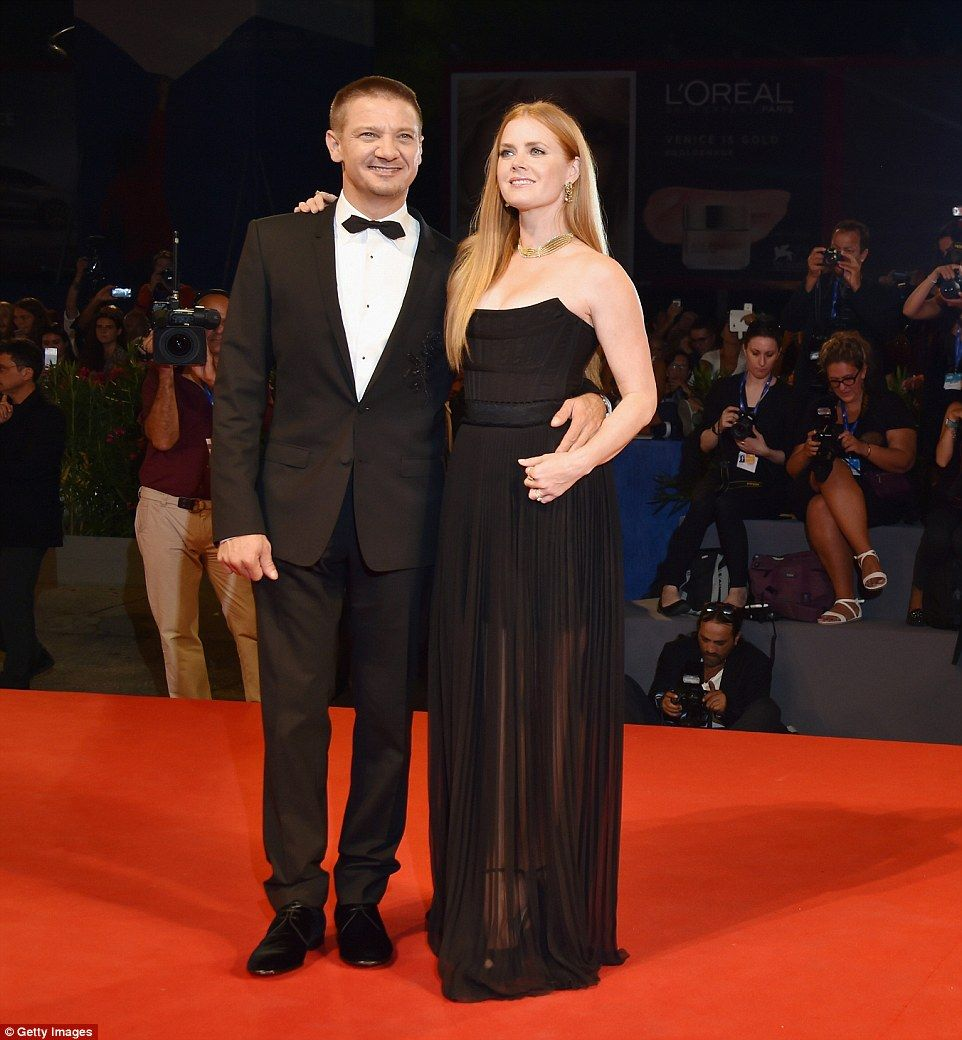 A picture of sophistication: Amy Adams and Jeremy Renner strolled down the red carpet at the premiere of their film Arrival at the Venice Film Festival on Thursday