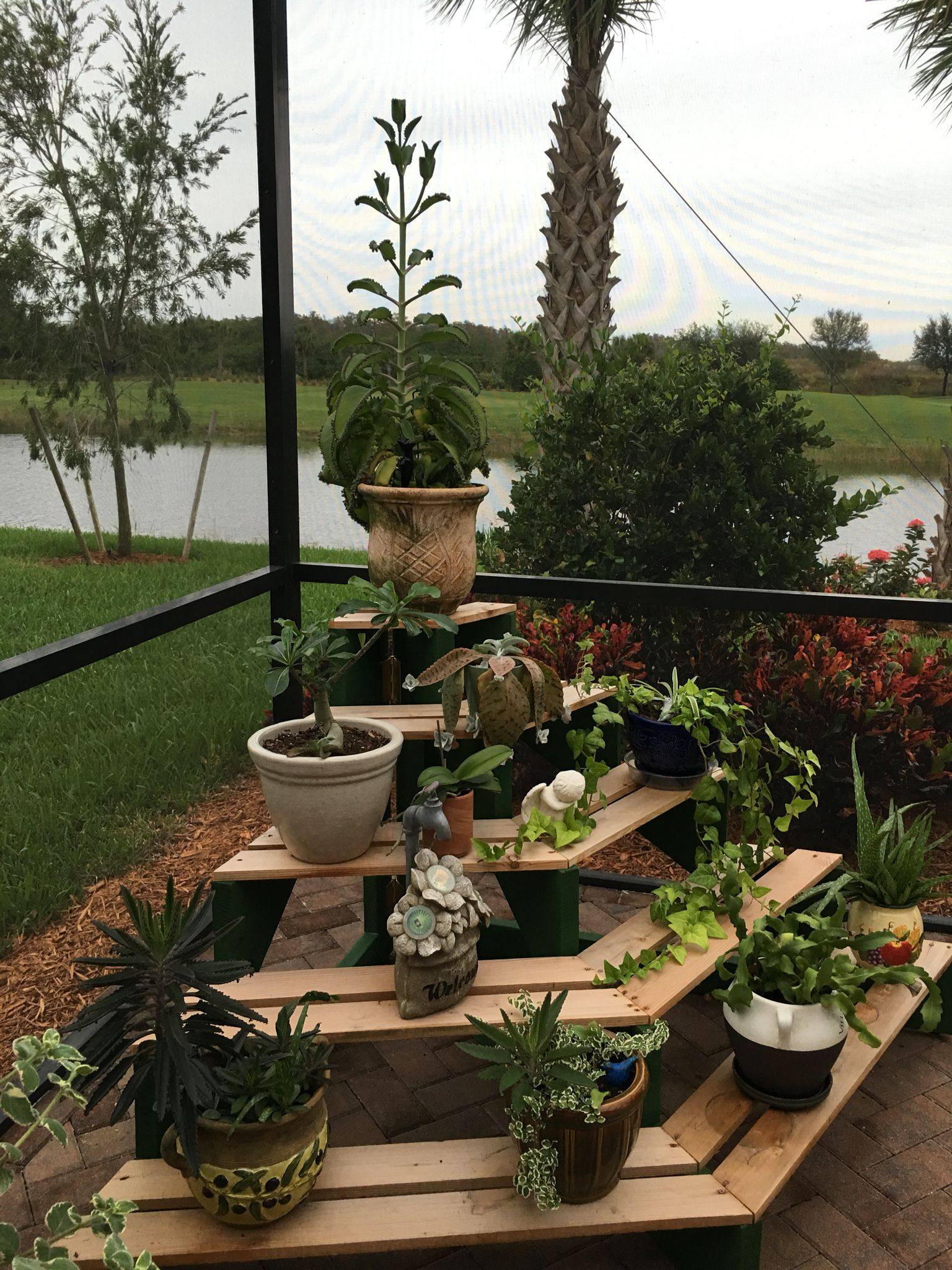 DIY 4 tiered wooden outdoor plant stand display. Plant