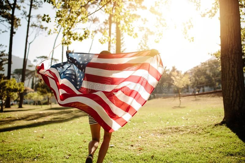Woman Running With American Flag In Park Woman Running With American Flag On A Sponsored Flag Park Amer Images Of Summer Running Women Fourth Of July