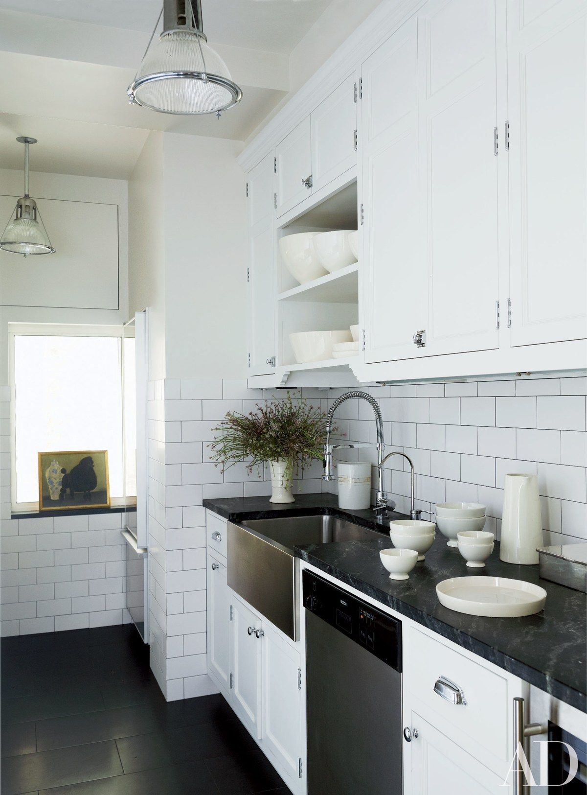 Subway tile by Nemo Tile Co. lines the kitchen of a classic prewar ...