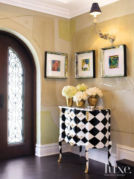 Entry vignette with patterned French cabinet