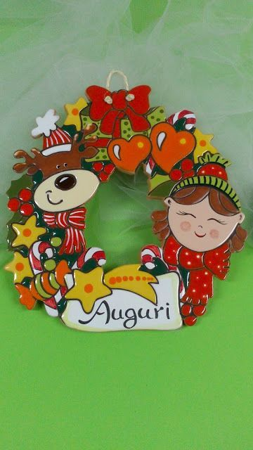 Photo of pottery as a craft: Merry Christmas outside wreath. Ceramic with …