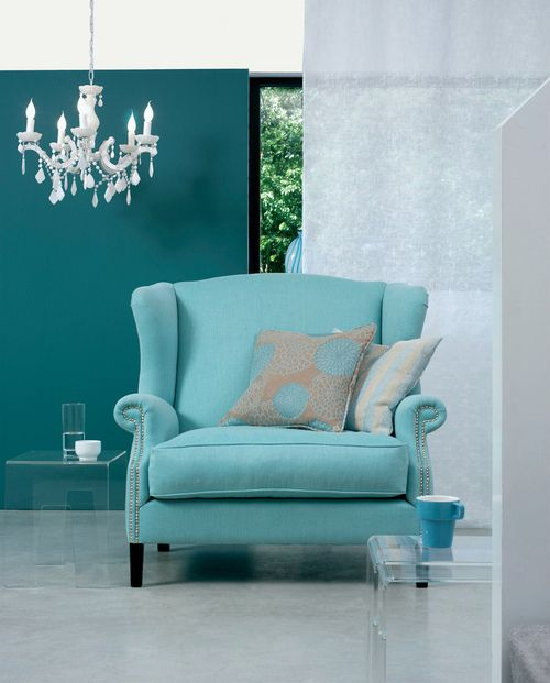Blue Chair Against Slightly Darker Blue Background Home