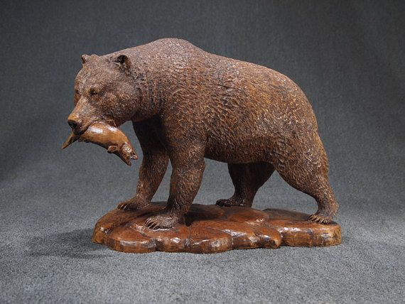 One for the road wood sculpture of bear with fish by