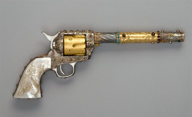 Performer Jack Sinclair's Colt Revolver, presented by the Knight's Templar. Jack Sinclair was the director of the Dodge City Cowboy Band. Dressed in full cowboy regalia from head to toe, the band was formed as a booster for the booming cowboy town of Dodge City, Kansas. Sinclair used this ornate Single Action Army as a baton to lead the band. He would fire blanks to punctuate the band's performance. #1891 #1890s