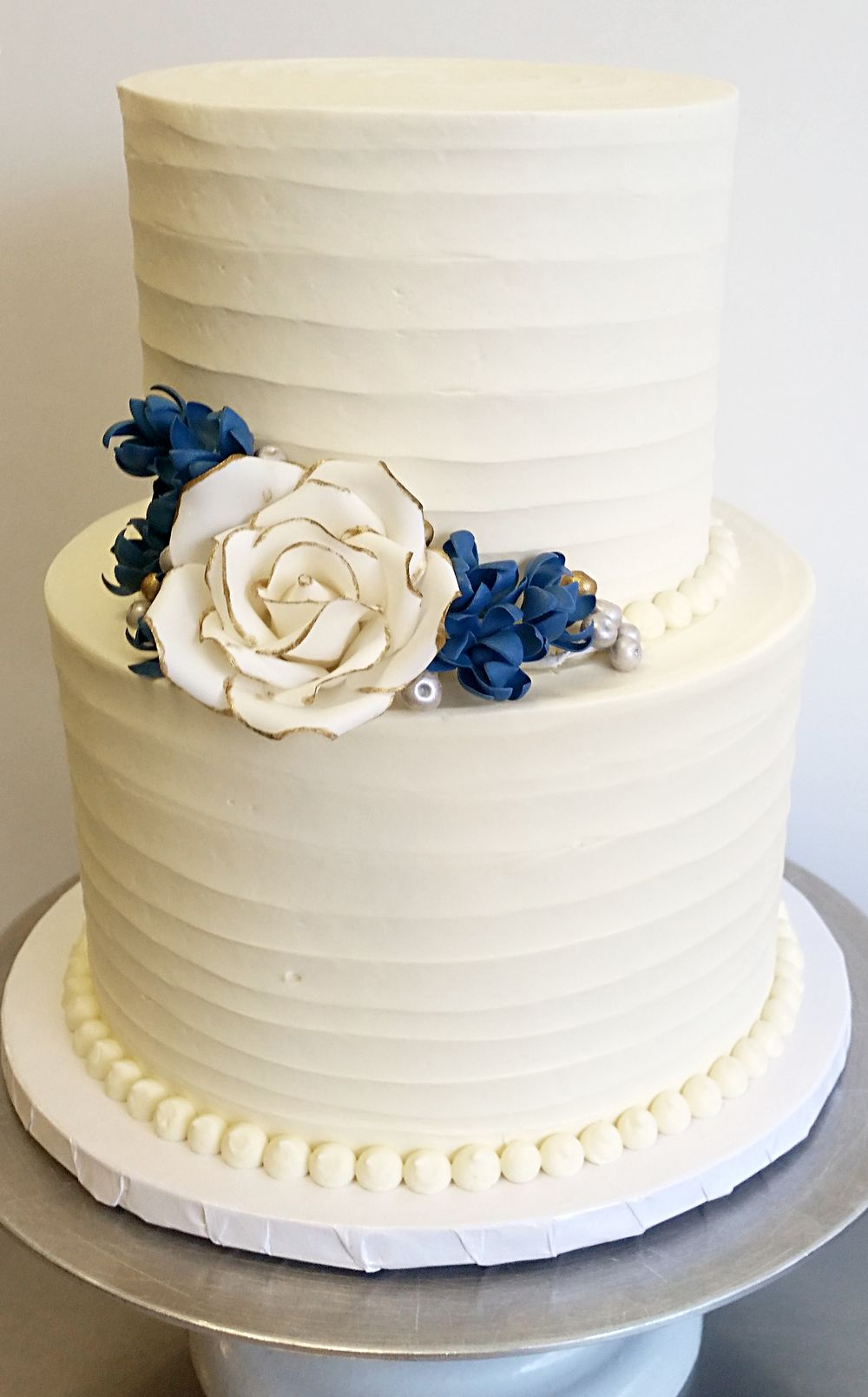 Textured buttercream with gum paste rose and blossoms (2