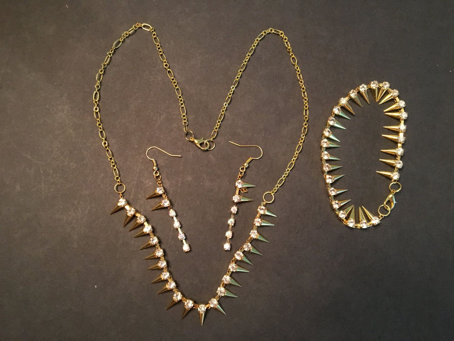 Hot funky spike gold necklace bracelet and earring set by