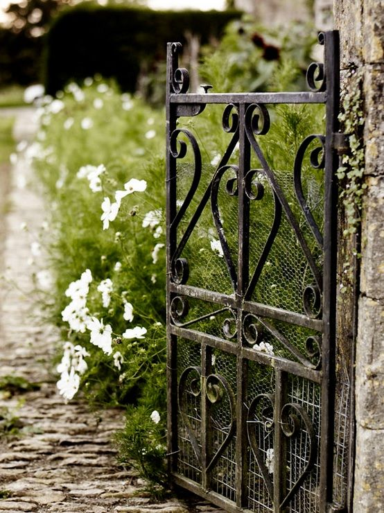 Wrought Iron Adds An Elegance To The Garden Garden gates