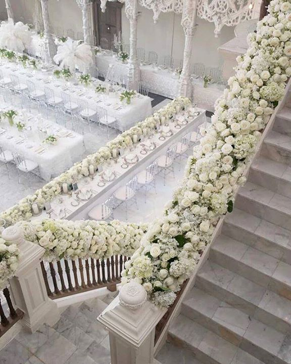 Decorating A Staircase Ideas Inspiration: A Staircase Filled With Flowers Makes The Entrance To A