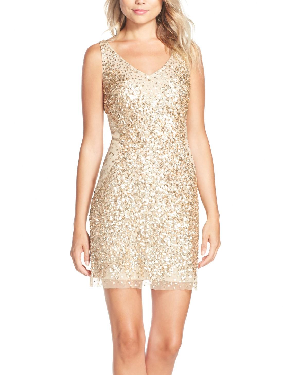 Allover gold metallic sequins make this flattering dress a statement ...