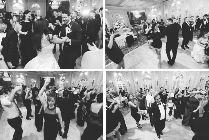 Guests dance during a wedding reception at the Essex House in NYC. Captured by NYC wedding photographer Ben Lau.