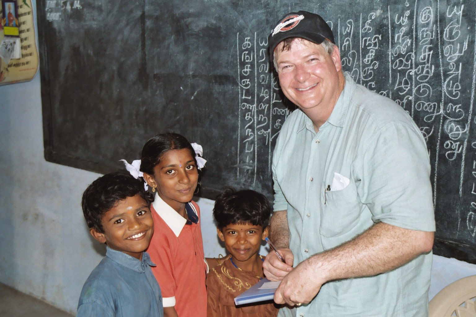 John with kids in village where Aravind was holding an eye camp