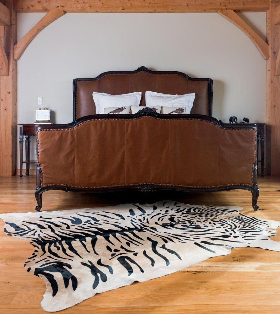 Wooden bed on sleek wooden floor with wood nightstand one home