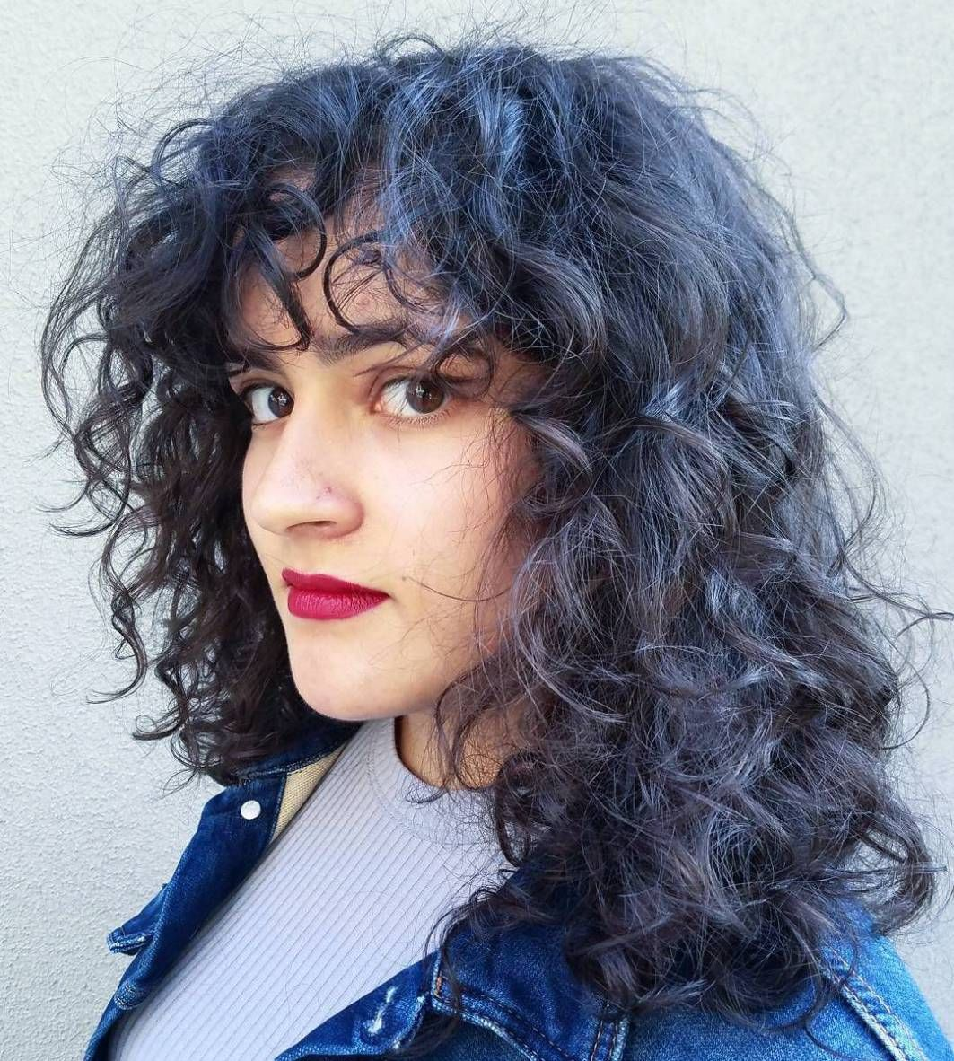 cute styles featuring curly hair with bangs curly medium