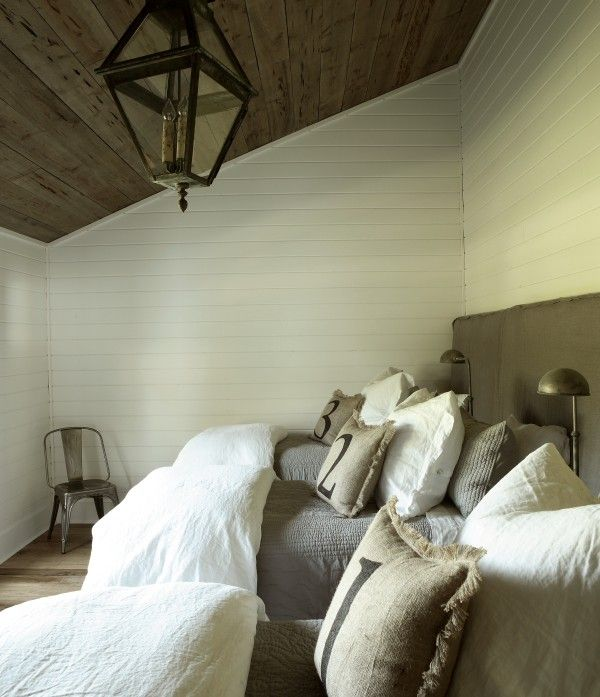 boy's rooms - wood sloped ceiling groove walls gray slipcover long headboard gray blanket burlap pillows  Gorgeous boys' bedroom with wood sloped