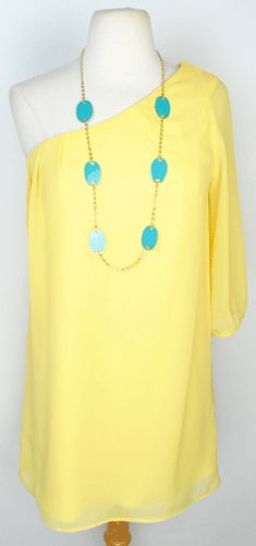 Like the color combo of the dress and neckless. Not so much the dress for me though it's cute.