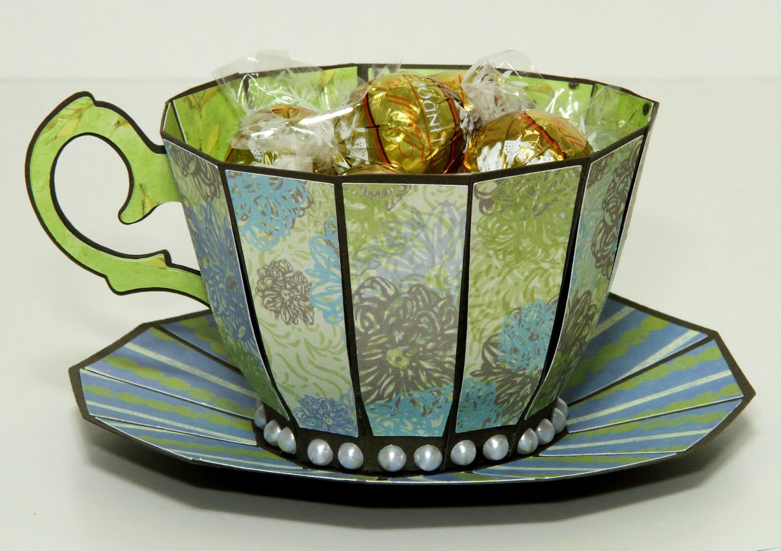 ... the cup with bone colored raffia and white chocolate truffles. Yum