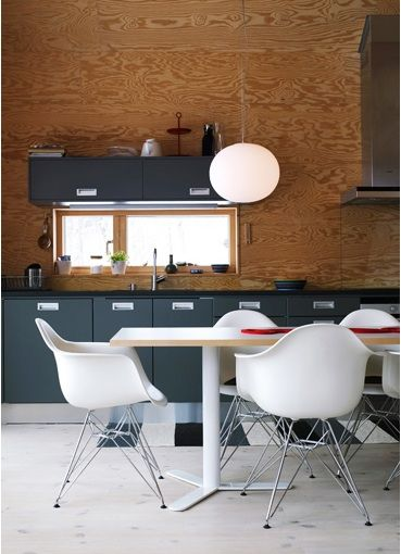 plywood, gray cabinets, white tulip chairs