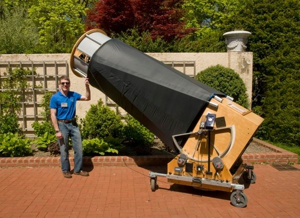 John Vogt with his self-made 32 inch Dobsonian telescope  A