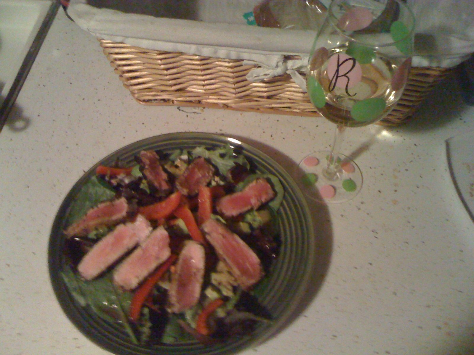 Seared Ahi Tuna on a bed of mixed greens with red peppers and a balsamic/srirracha dressing
