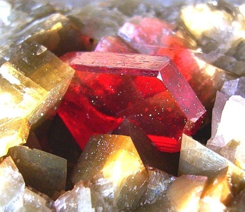 Cinnabar, HgS, crystal on siderite, Erzberg Halde, Eisenerz, Styria, Austria. Specimen 11 cm. Crystal: 1.2 cm. Collection/Copyright: Peter Rothenburger