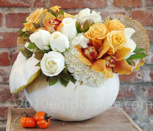 White roses, orange orchids in white pumpkin. | Holiday Flowers ...