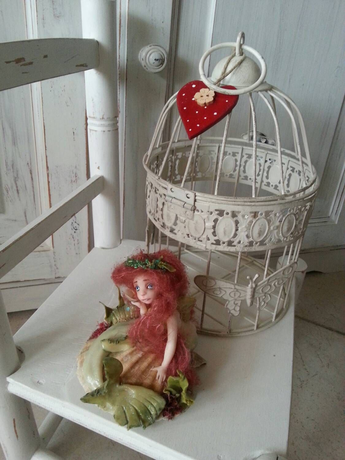 Fairy mermaid in white cage