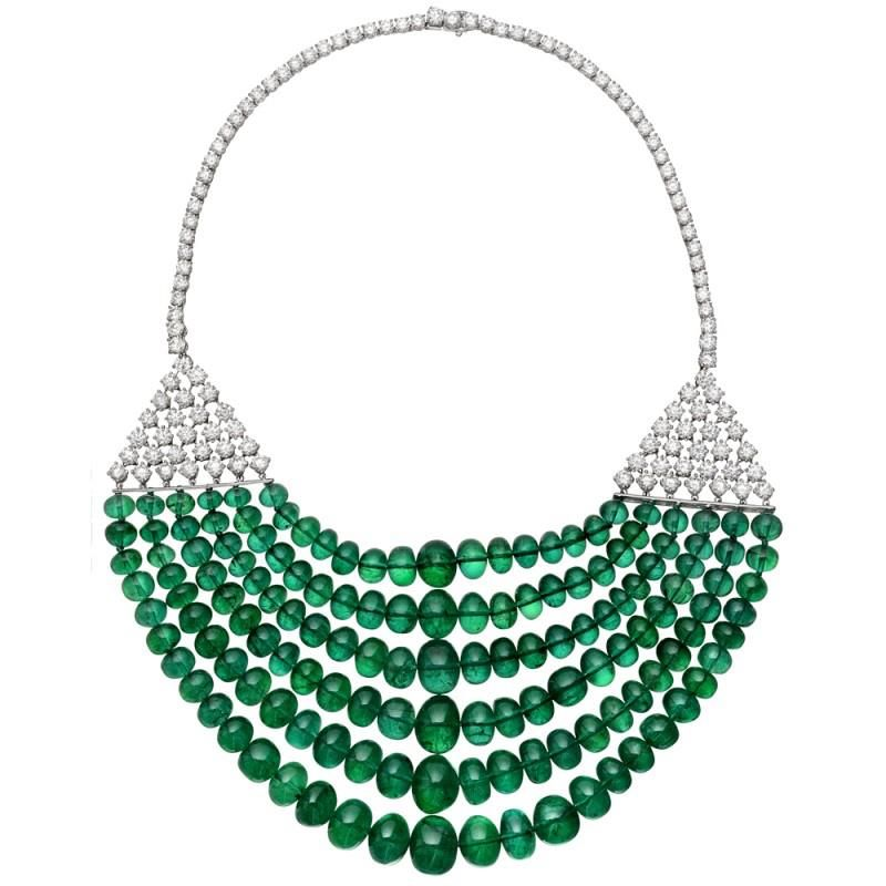 Magnificent 6-strand graduated emerald bead necklace, suspended from a diamond-set lattice to a diamond-set line necklace, mounted in platinum. The emeralds weighing 586.07 total carats and diamonds weighing 26.50 total carats. Designed by Goshwara.