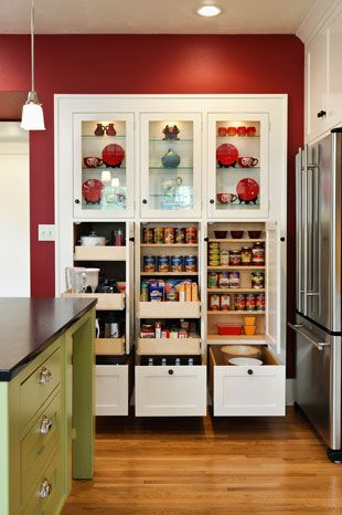 Ious Pantry Cabinets East Wall In Kitchen Built Like A Piece Of Furniture The Lighted Gl Display Above
