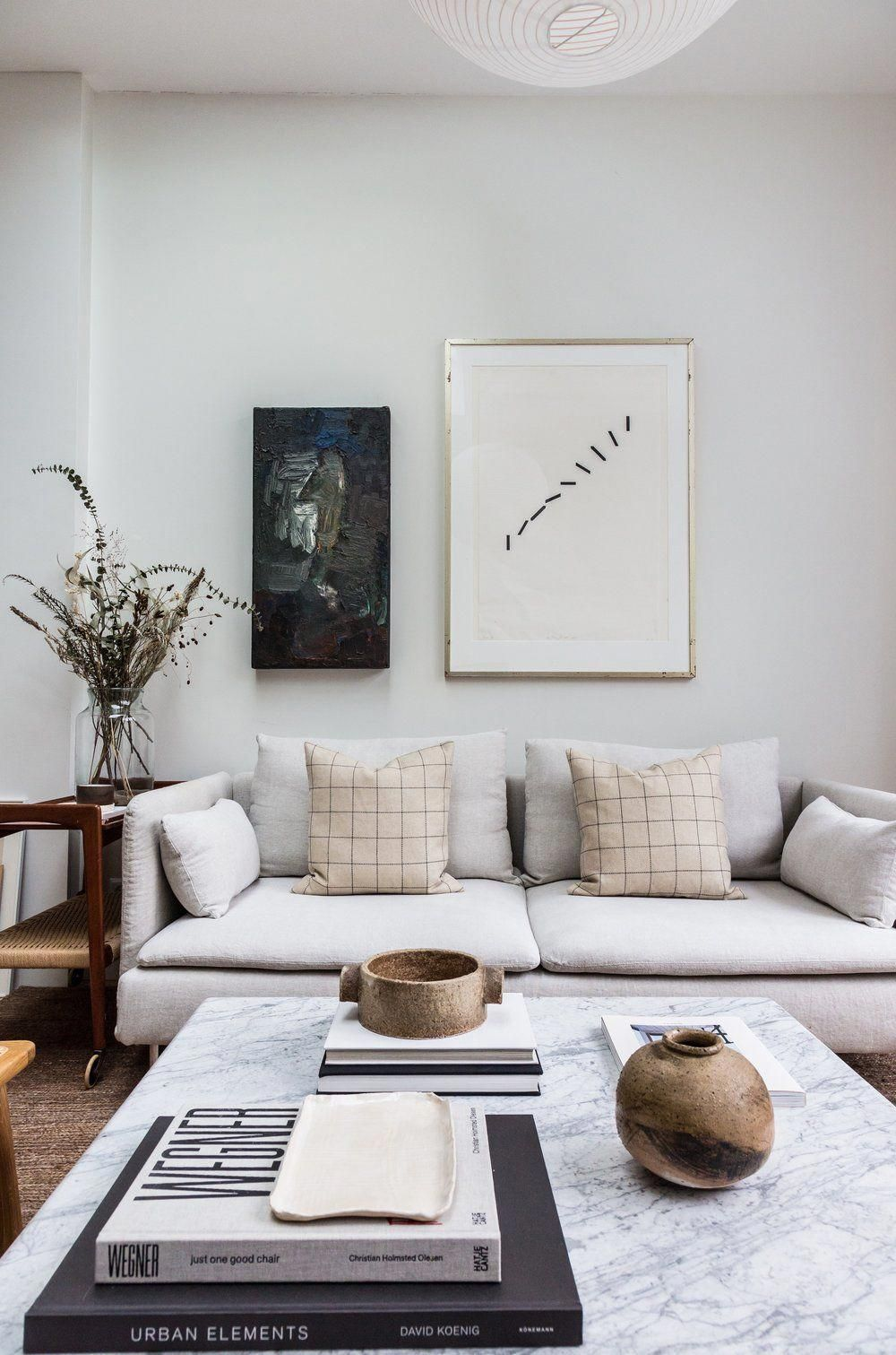 Light colored living room with IKEA Soderhamn sofa with Bemz cover in Holly Marder's light family home in a 1920s Dutch row house  #soderhamn #ikeasoderhamn #bemzcover #livingroomdesign #livingroominspiration