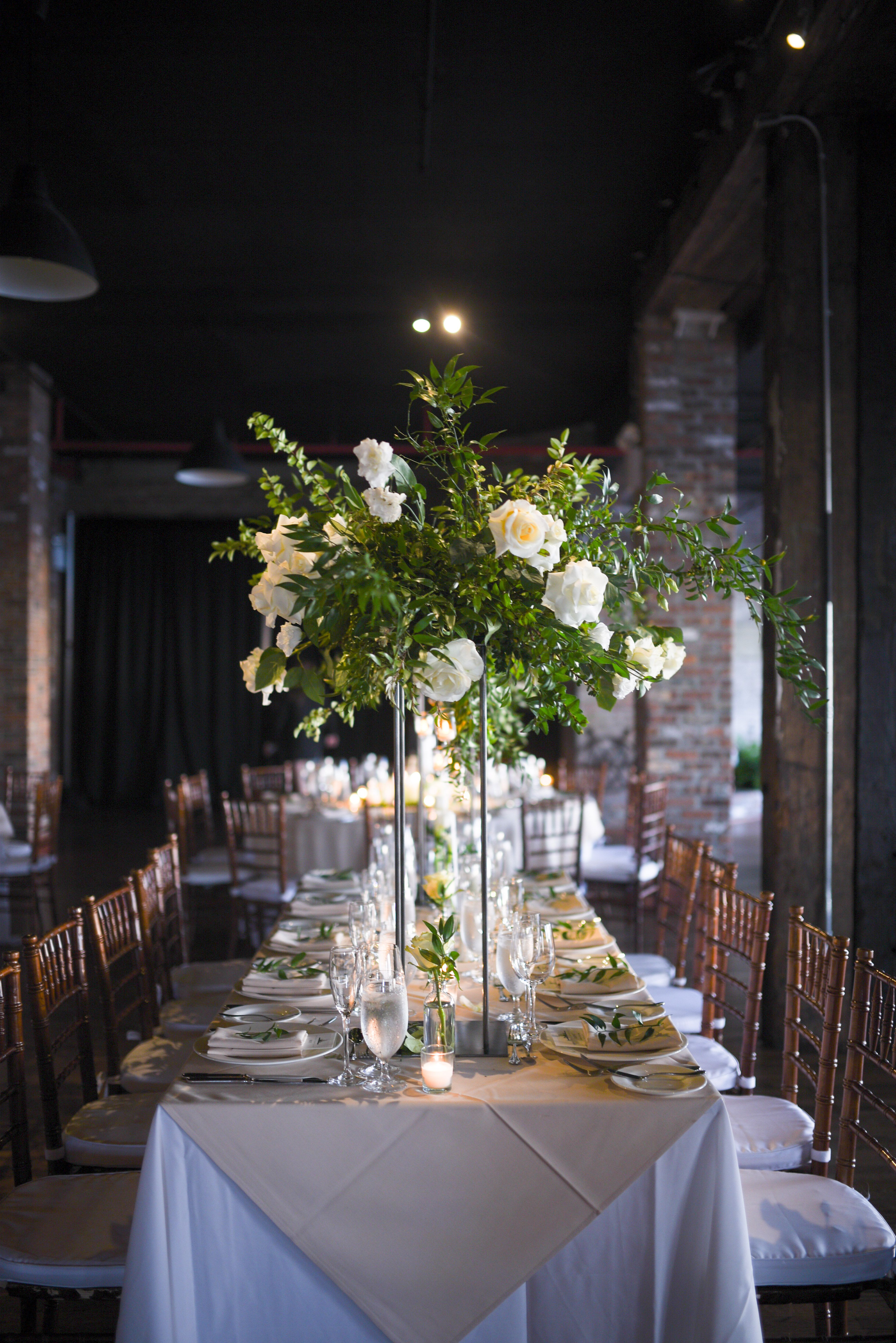 Liberty Warehouse Wedding Autumn Wedding Featuring Neutral W Flower Centerpieces Wedding Wedding Flower Centerpieces Tall White Wedding Flowers Centerpieces