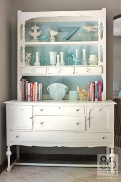 Easy DIY - paint the inside back wall of your hutch shelves or bookshelves a fun color! http://86lemons.com/hutch-mini-makeover/