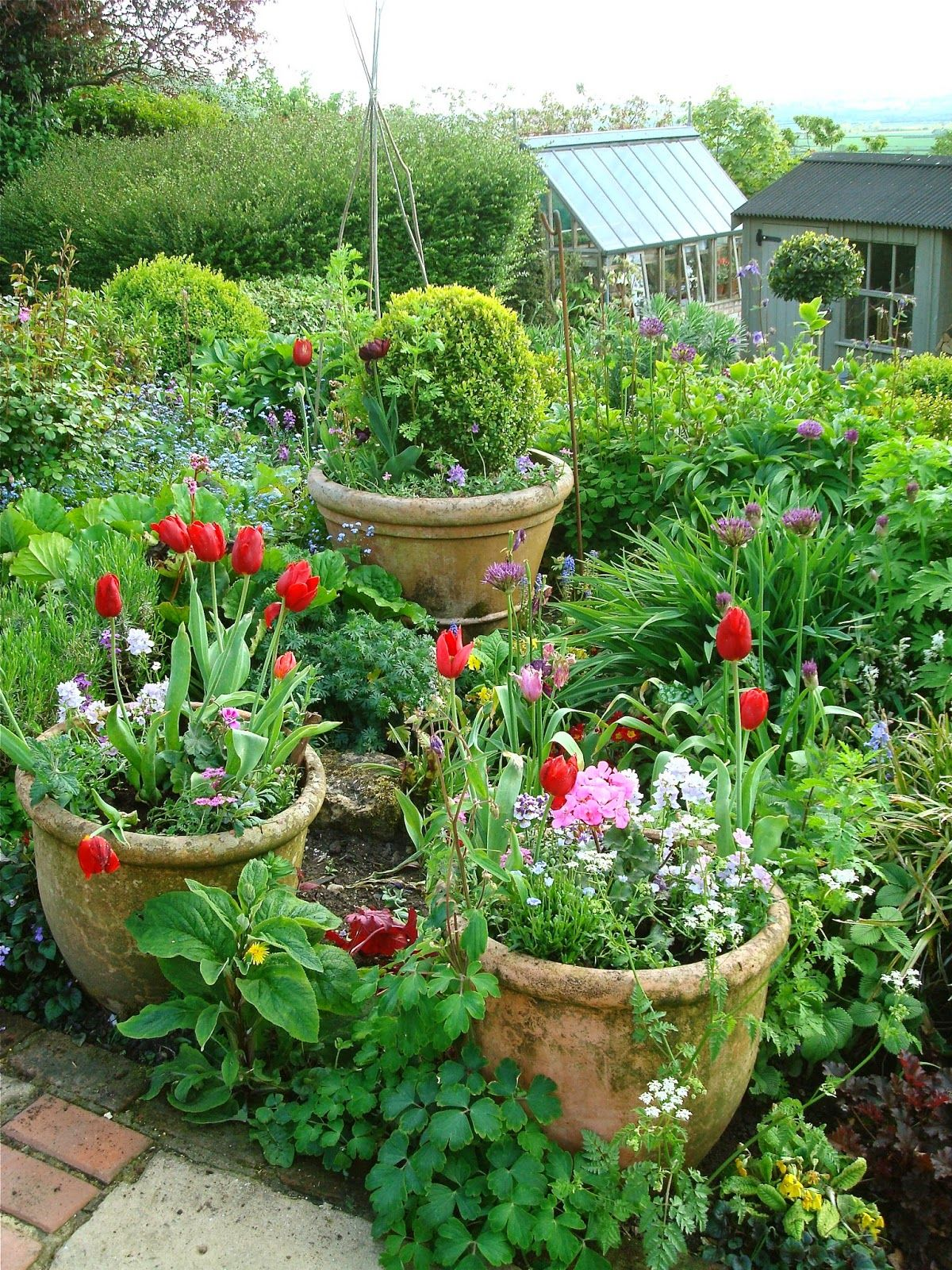 Cottage Garden Pots The more pots in the garden the less time on your knees pulling the more pots in the garden the less time on your knees pulling weeds workwithnaturefo