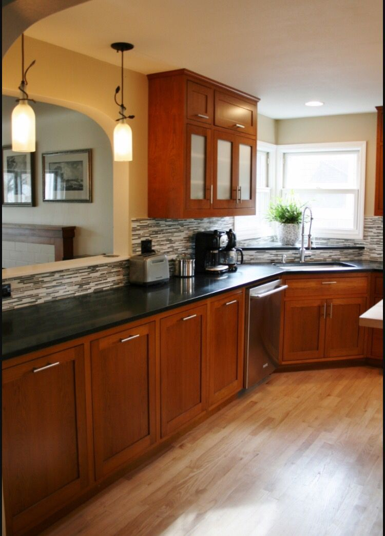 Black granite counter tops | Cherry wood kitchen cabinets ... on Backsplash Ideas For Black Granite Countertops And Cherry Cabinets  id=99185