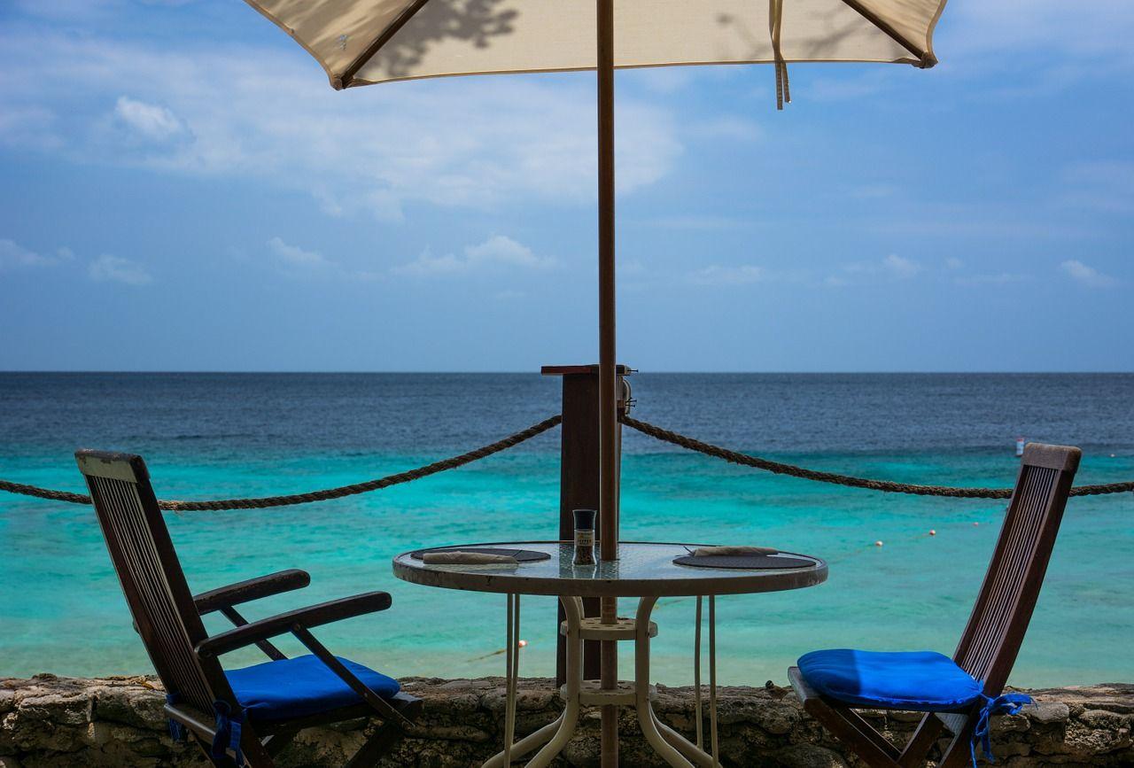 umbrella on the beach Patio chairs, Patio, Umbrella