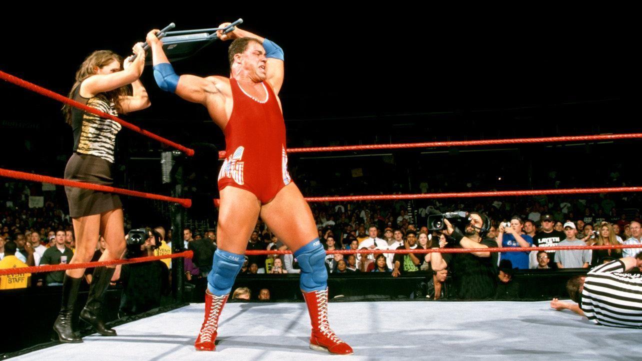 Stephanie McMahonHelmley stops Kurt Angle from hitting Triple H – Wwf Chair