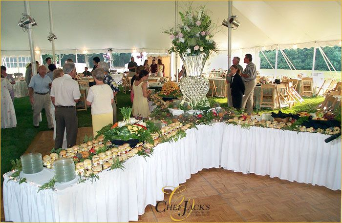 add height to your buffet table for a professional look you can use wood crates flipped upside down and cover them with additional layers of linens to