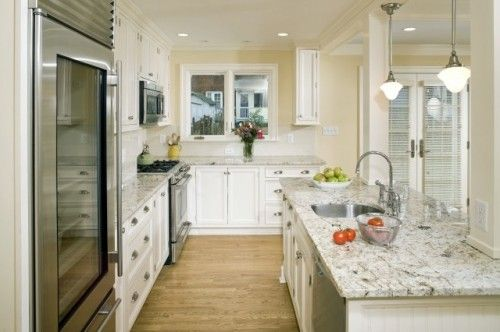 White Fantasy Granite: traditional kitchen by Erin Hoopes