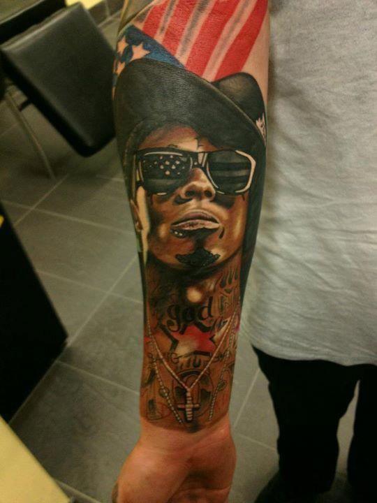 By owner of tattoo lil wayne tattooed on my arm by aj for Tyga arm tattoos